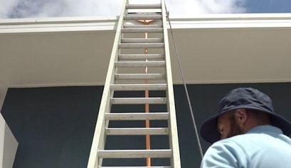 man using ladder